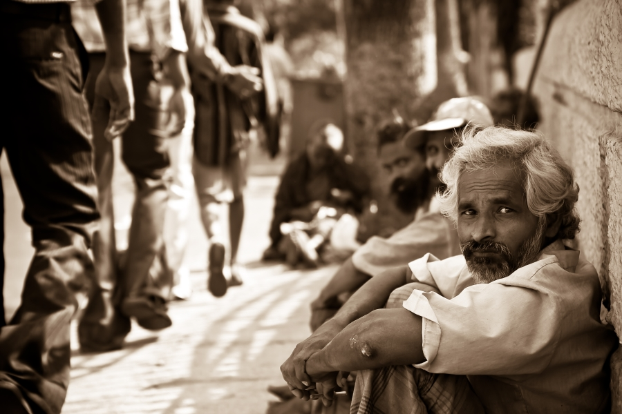 Men_seated_on_the_ground_in_Mylapore,_Chennai,_Tamil_Nadu,_India_-_20080511